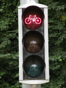 A traffic light on a bike path in Brussels is an example of European investment in bicycles as transportation